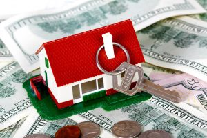 Family house with money and key